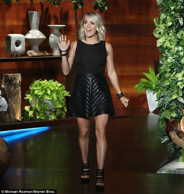 Legs eleven! The starlet stepped onto the stage in a black skirt and matching tank top
