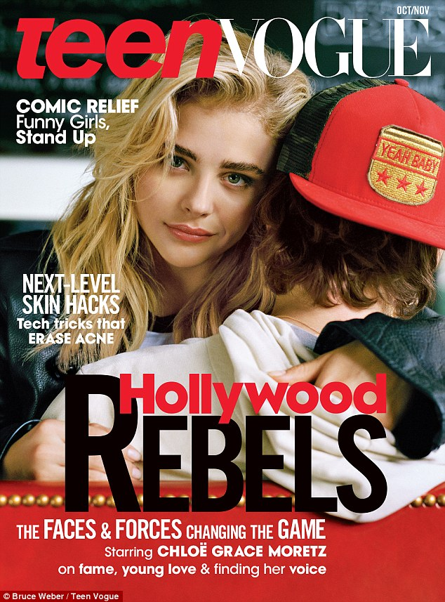 Her old love: Chloe Moretz is seen hugging her ex Brooklyn Beckham on the new cover of Teen Vogue, which was shot just before their split. His face cannot be seen but he is known to wear that Yeah Baby cap