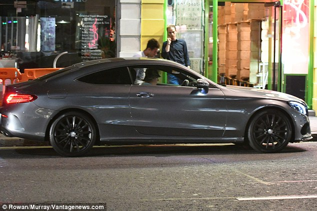 Hot wheels: Brooklyn looked to be in good spirits as he hit the town in his shiny, new Mercedes C-Class, which he picked up in July after passing his driving test