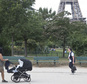 People stroll in the Champ de Mars garden near the Eiffel Tower, beside the spot where a woman was allegedly raped earlier this week,  in Paris, Friday, Sept. 16, 2016. Three Algerian young men have been arrested in Paris under suspicion of raping a woman near the Eiffel Tower, according to a police official. One of the suspects chatted with her on Facebook days earlier and gave her an appointment. (AP Photo/Michel Euler)