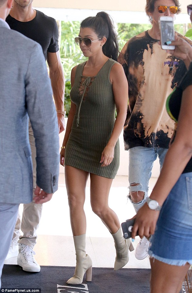 No sweat! Kourtney wowed as she stepped out in a sleeveless olive sweater dress