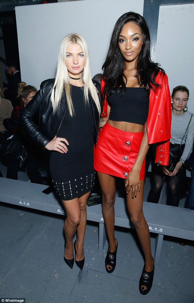 Me and my pals: Jourdan caught up with friend Jessica Hart who sported a studded skirt and heels