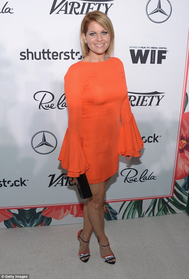 Bold: Candace Cameron Bure added a pop of color to the attendees as she opted for a bright orange mini-dress