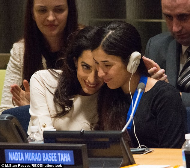 All smiles: Mrs. Clooney appeared poised as she addressed the audience and offered a friendly smile to Nadia and a warm embrace
