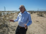 "Adelanto councilman John ""Bug"" Woodard, Jr. stands on undeveloped desert land in the ""green zone"", an area designated by the city for industrial scale marijuana cultivation ©David McNew (AFP)"
