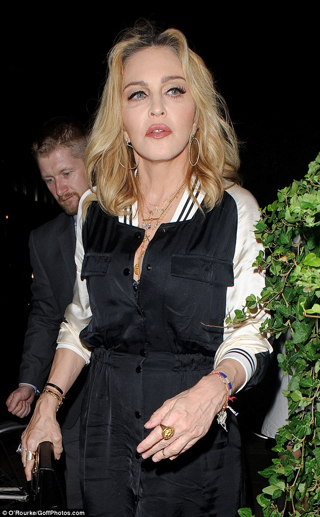 Looking after her boy: Madonna reportedly made an emergency dash to the UK after she discovered Guy Ritchie left son Rocco home alone to go on holiday to LA