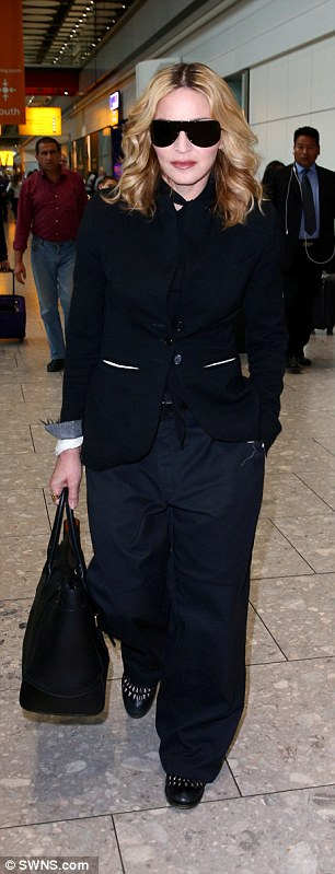 Casual: Despite the seven hour flight Madonna looked fresh as a daisy on her arrival