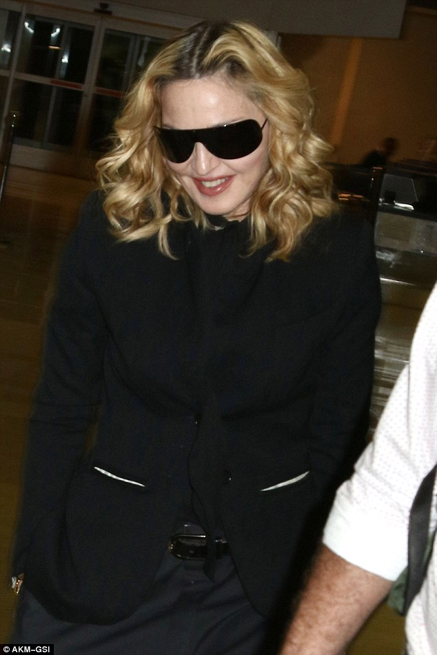 Blazer her trail: The star also wore a sharp and trendy coat as she arrived at JFK