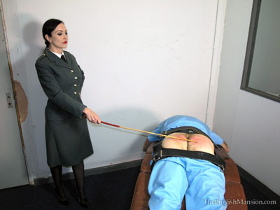 Judical caning in prison by female officer