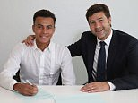 ENFIELD, ENGLAND - SEPTEMBER 06: Dele Alli of Tottenham Hotspur poses with manager Mauricio Pochettino while signing a new contract on September 6, 2016 in Enfield, England. (Photo by Tottenham Hotspur FC/Tottenham Hotspur FC via Getty Images)