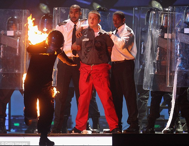 Did you steal Take That's dancers? Plan B - who won British Male Solo Artist - performed two of his hits with his backing dancers dressed as riot police, one of whom was on fire