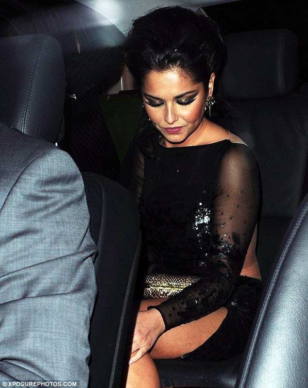 Take me home: After a couple of hours at the party, Cheryl headed home to north London in her chauffeur-driven car