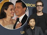 """Actor Brad Pitt poses with his children Pax (L), Shiloh (2nd L) and Maddox, and his mother Jane Etta at the premiere of """"Unbroken"""" at Dolby theatre in Hollywood, California December 15, 2014. The movie opens in the U.S. on December 25.   REUTERS/Mario Anzuoni  (UNITED STATES - Tags: ENTERTAINMENT)"""