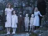 """FILE - In this image released by 20th Century Fox, from left, Lauren McCrostie, Pixie Davies, Cameron King, Thomas and Joseph Odwell and Ella Purnell appear in a scene from, """"Miss Peregrine¿s Home for Peculiar Children"""".  In a crowded autumn weekend at the box office, ¿Miss Peregrine¿s Home for Peculiar Children¿ came out on top. (Jay Maidment/20th Century Fox via AP, File)"""