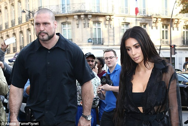 On the night of the raid, Kim's bodyguard Pascal Duvier (left, in file image with Kim) was at a nightclub with her sister Kourtney