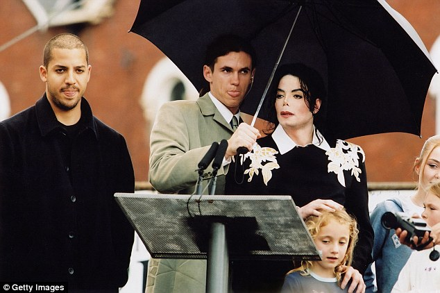 Matt Fiddes (pictured with umbrella), Michael Jackson's former bodyguard, believes it was fishy that Kim was left completely alone