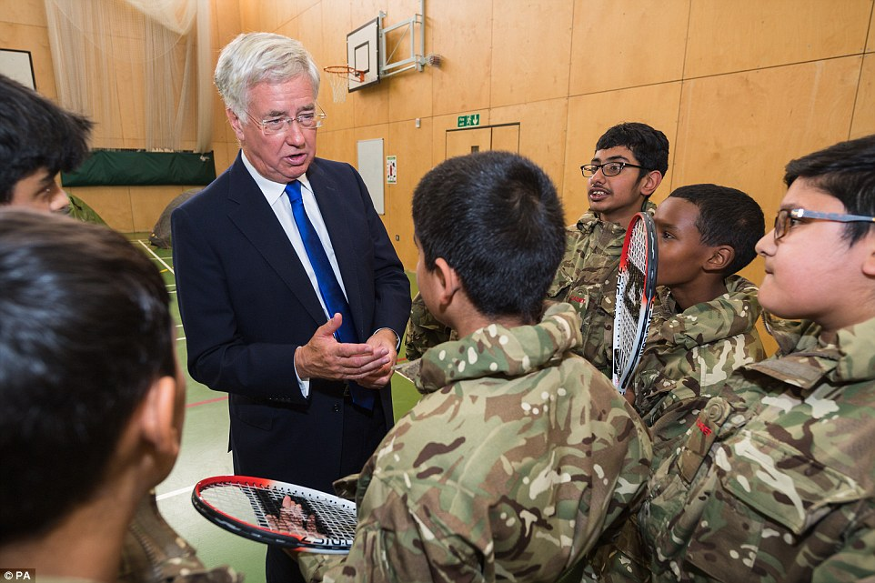 Sir Michael, pictured with military cadets, said he would go to Barrow to personally