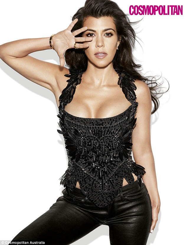Busty display:In one shot, the November cover girl is seen flaunting her ample assets and glowing complexion while wearing a beaded black halter corset and matching skinny pants