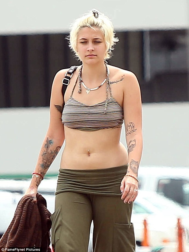 Someone's been doing their sit-ups: Paris sported a taut stomach on the fall vacation