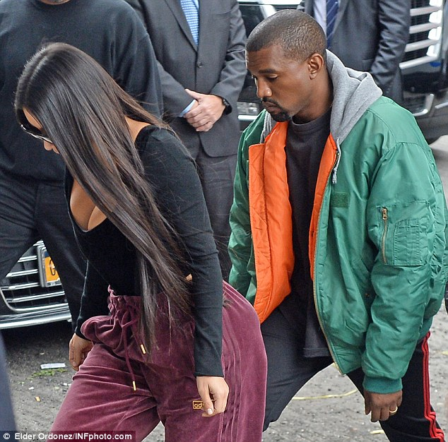 As details emerged of how Kim was tailed in the days preceding the robbery, the star told close friends how she feared she would be raped by her attackers. Pictured: Kim reunited with husband Kanye West in New York on Monday
