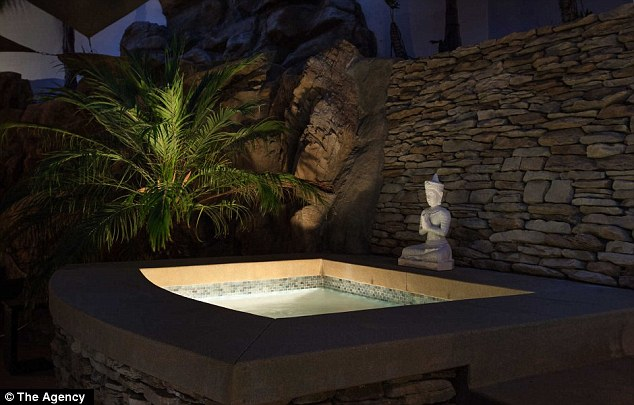 Relaxing: The Jacuzzi's elegance is enhanced by the all-stone motif in the area