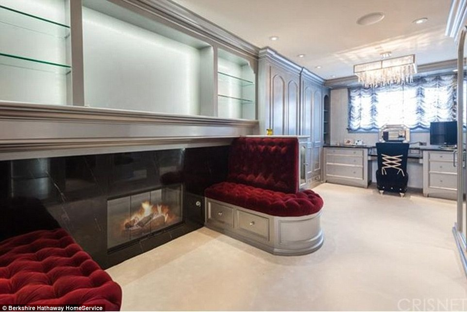 Room for clothes and more: The walk-in closet is more like a room with its own fireplace, banquettes and vanity area with a corset chair