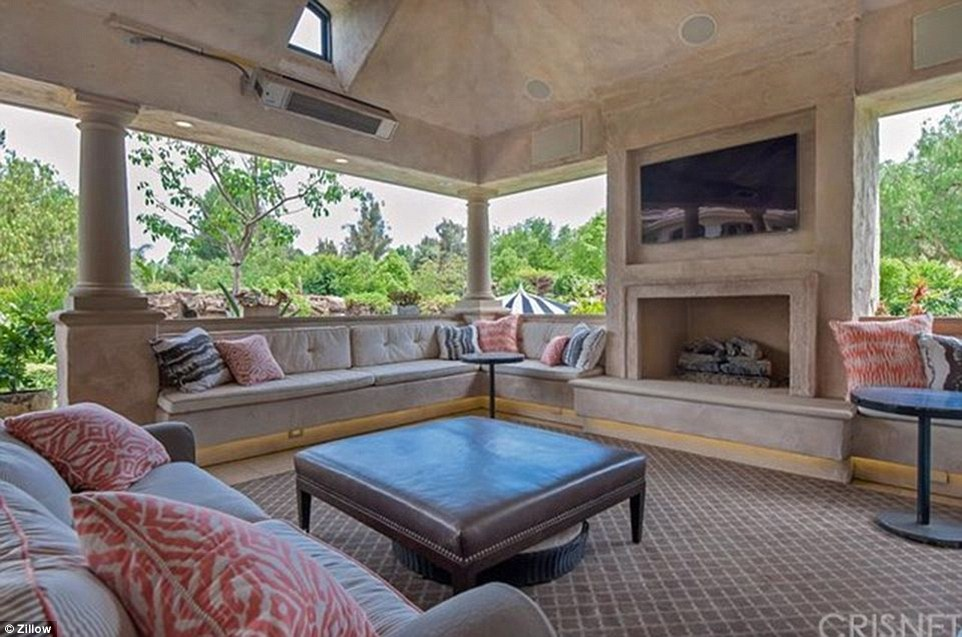 Outdoor living: The cabana also has a living area with fireplace and flat screen television