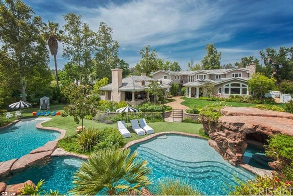 Water park: The 1.4 acre estate has room for two free-form swimming pools as well as manicured lawns and lush landscaping