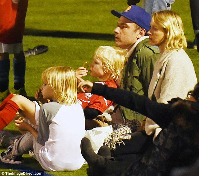 Quartet: The whole family reunited last Saturday, five days after the split, to watch Alexander's football match in New York City