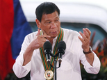 Philippine President Rodrigo Duterte gestures with a firing stance as he announces issuing side arms to army troopers during his visit to its headquarters in suburban Taguig city east of Manila, Philippines Tuesday Oct. 4, 2016. U.S. and Philippine forces opened their first large scale combat exercises under President Duterte in uncertainty Tuesday after he said the drills will be the last in his six-year presidency partly to avoid upsetting China.(AP Photo/Bullit Marquez)