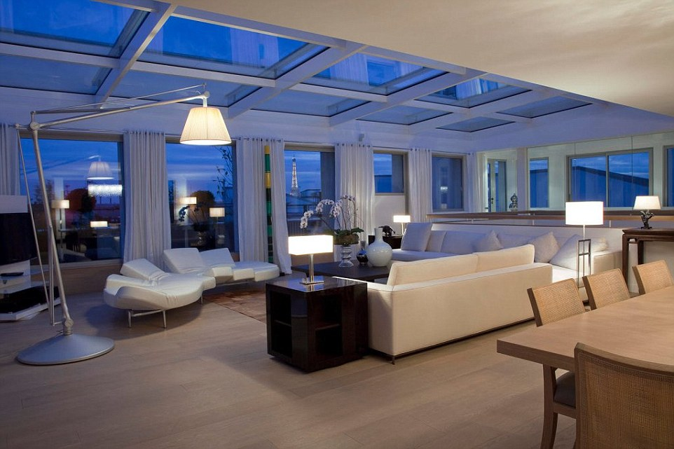 Pictured is one of the luxurious main rooms in the complex where Kim Kardashian had millions of dollars worth of jewelry stolen by five armed masked men dressed as police officers. The Eiffel Tower can be seen from the window