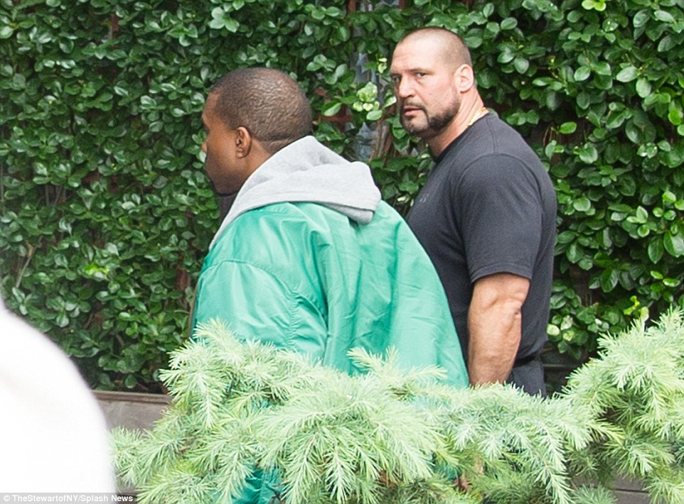 French police said a robbery, on such a high-profile celebrity, could 'onlyhave been carried out by a sophisticated international criminal organisation'. Pictured: Kim's bodyguard Pascal Duvier (grey t-shirt) in New York with Kanye West
