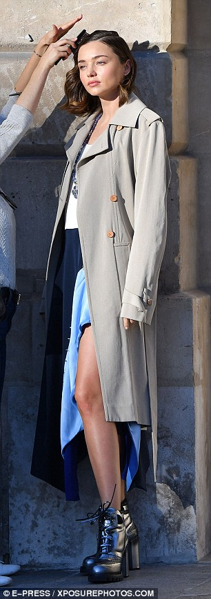 Showing a little skin: The 33-year-old star wore a colourblock dress and beige trench coat