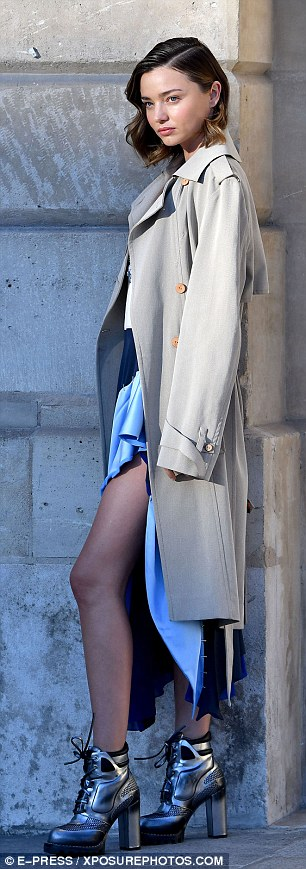 Showing a little skin: The 33-year-old star wore a colourblock dress and beige trench coat as she posed inPlace Vendome