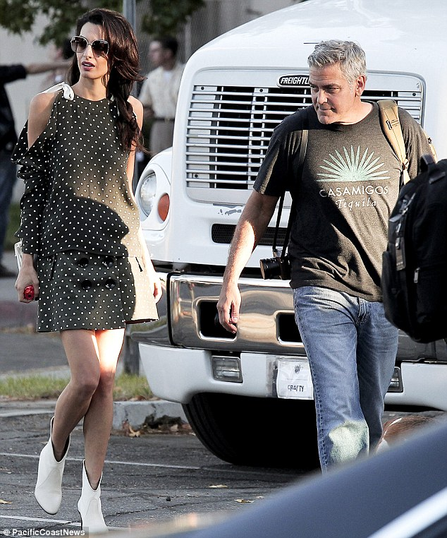 Squeezing in some romance: The pair were seen going for a stroll together through the set