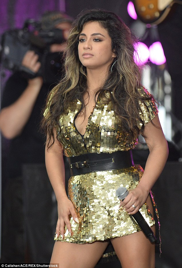 Unwanted attention: Ally Brooke was ambushed onstage by a fan as she performed with her Fifth Harmony bandmates in Mexico on Thursday night