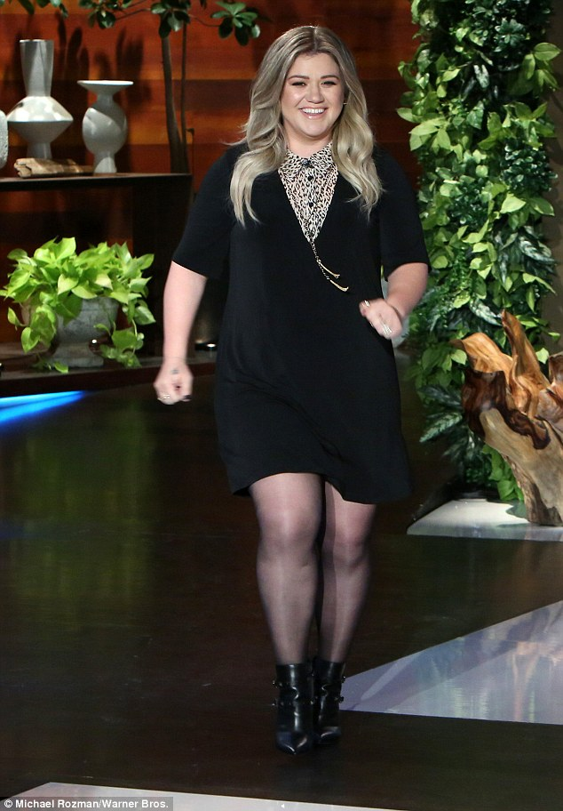 Slimmer figure: Kelly Clarkson made an appearance on The Ellen DeGeneres Show on Monday to promote her new children's book and looked fabulous in a black dress and ankle boots
