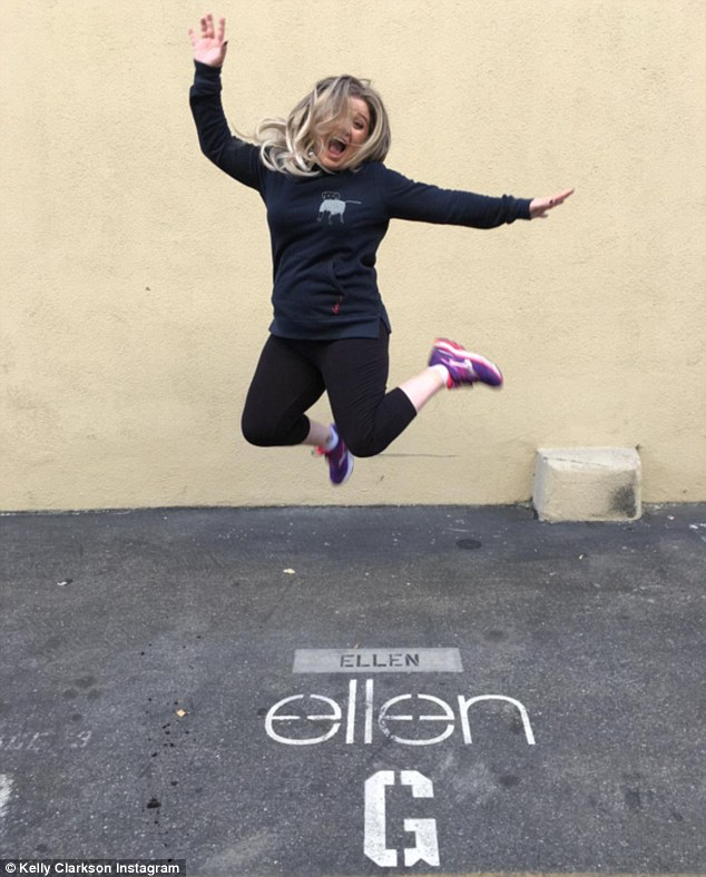 Fit and healthy: The singer, 34, jumped for joy as she made the first stop on her book tour, showing off her weight loss in leggings and a hoodie
