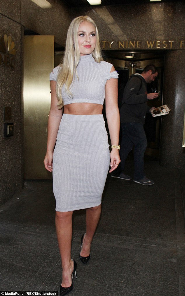 Wowing the masses: Lindsey Vonn showcased her amazingly svelte waistline in a clingy two-piece ensemble while promoting her new bookStrong Is The New Beautiful in NYC on Tuesday
