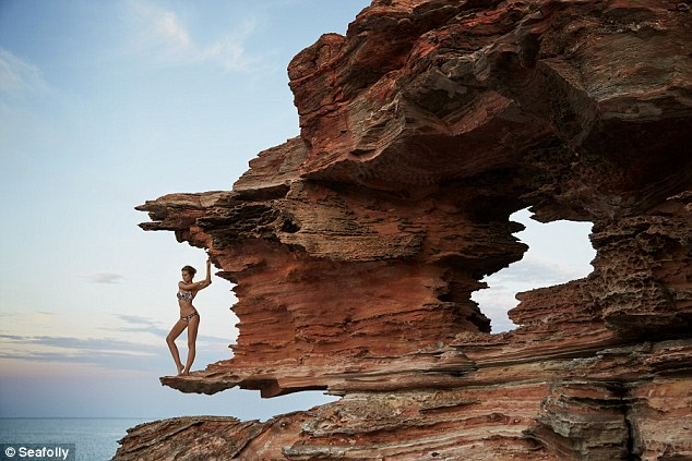 Impressive! The Australian beauty showcased her long, lean legs standing atop a beach-side cliff edge, with the breathtaking landscape encapsulating the shot