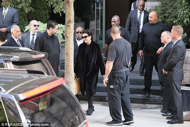 Upping the security: Kris Jenner, 60, stepped out for the first time since her daughter Kim was held at gunpoint on Monday, with eleven security guards in tow