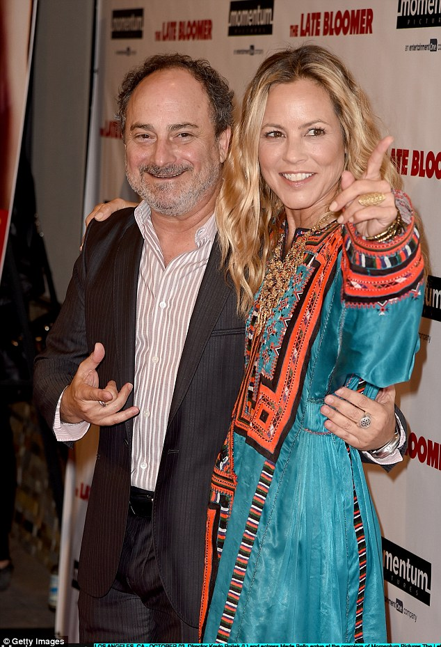 Look at my hand!Maria Bello flashed a gold ring on Monday night when at the Late Bloomer premiere at iPic in Los Angeles; here she is posed with director Kevin Pollak