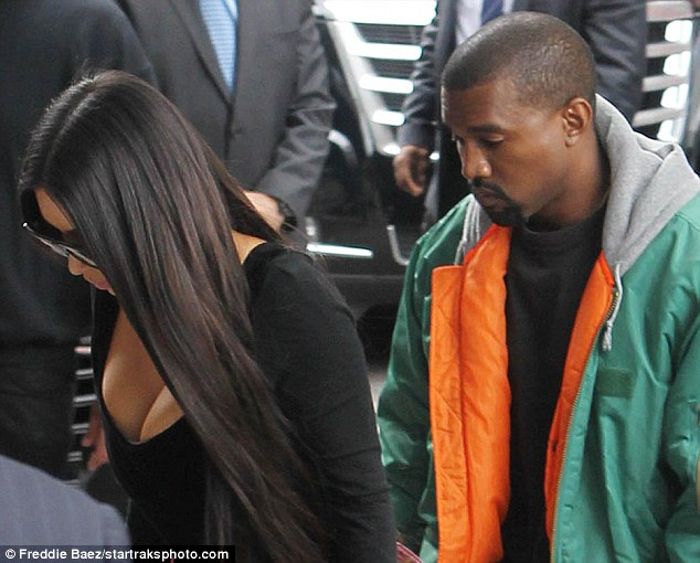 Kim Kardashian was greeted by rapper husband Kanye West (right) as she touched down in New York after her terrifying ordeal in Paris