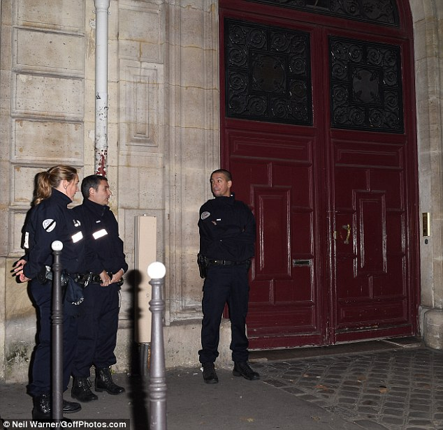 French police officers stood guard outside the scene of the robbery at the Hotel de Pourtalès (pictured) complex where armed robbers bound and gagged Kardashian
