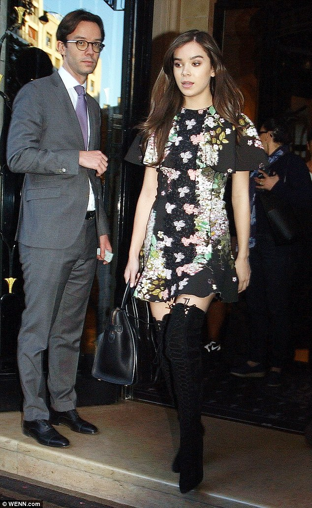 Fashion forward: She was seen on Monday leaving the George V hotel in Paris, a few blocks from the apartment where Kim was tied up and robbed in the early hours of Monday morning