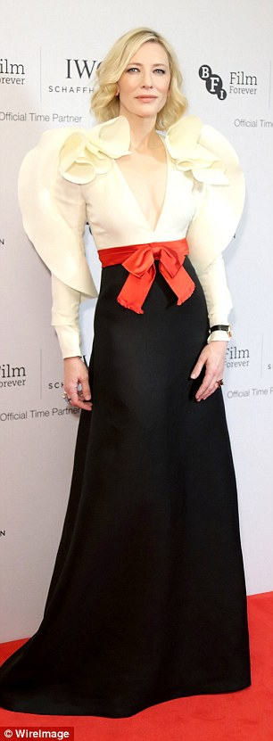 Red hot: The striking garment boasted a floor-length black skirt and was pulled together with a bright red bow at the waist