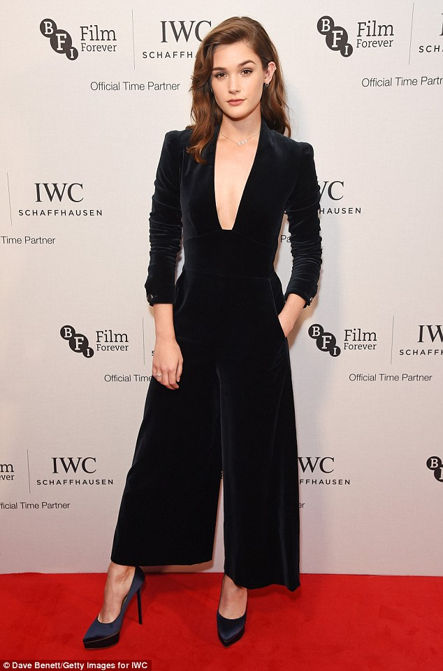 Glamorous: The rising star looked incredible in the flared ensemble, which boasted a daring, extreme plunging neckline