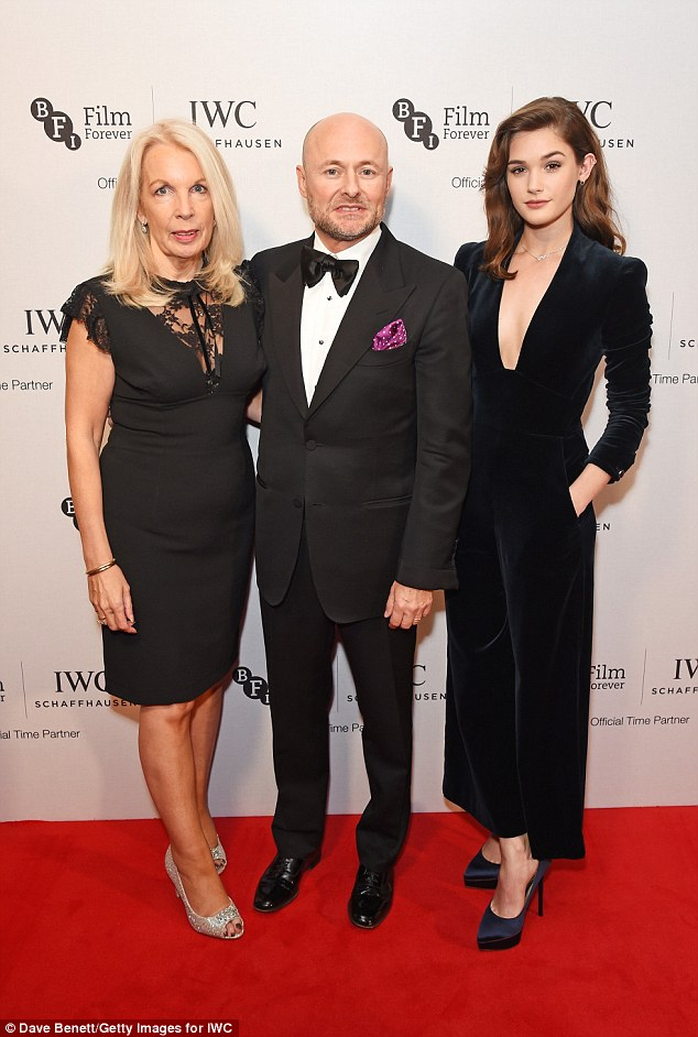Strike a pose: Sai cosied up to Amanda Nevill, BFI CEO, and Georges Kern, IWC CEO, as she made her red carpet arrival