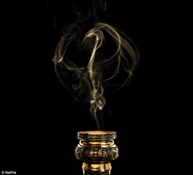 Up in smoke: In the quick teaser, incense wafts into the shape of Daniel Rand's logo - the dragon (Shou-Lao the Undying) he slayed as a teenager, which gave him his superpowers