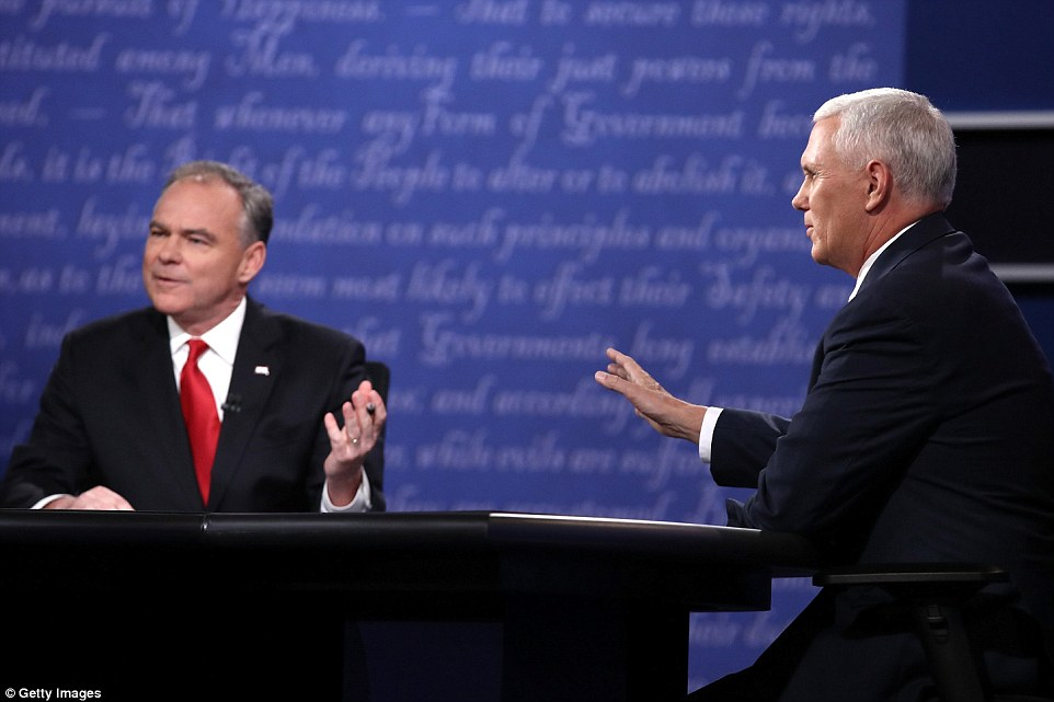 'Iraq has been overrun by ISIS,' Pence (right) said, 'because Hillary Clinton failed to renegotiate a status of forces agreement' with the Iraqi government.